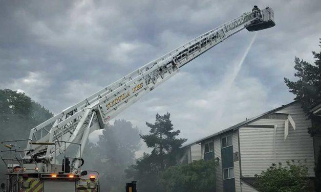 Firefighters battle blaze at unoccupied apartment building in Tukwila Thursday morning
